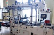 Оборудование для вклеивания окошек в типографии «Индустрия цвета»